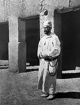 Roger-Viollet | 162830 | Charles de Foucauld (1858-1916), French explorer and monk, in front of his hut in Morocco. | © Albert Harlingue / Roger-Viollet