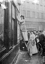 Roger-Viollet | 195923 | Paris - First women working as billstickers | © Maurice-Louis Branger / Roger-Viollet