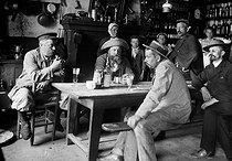 Roger-Viollet | 196925 | Inside a café in Brittany, about 1900. | © Neurdein / Roger-Viollet