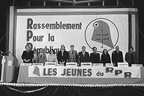 Roger-Viollet   200056   Speech of Nicolas Sarkozy, national delegate for the Youth of the RPR ( Rassemblement pour la République , Rally for the Republic), French centre-right political party. Congress in the presence of Charles Pasqua, cofounder of the RPR, Brice Hortefeux and Roger Karoutchi, Nicole Chouraqui, Gérard Kuster, Alain Devaquet, deputy of Paris, J. Ravend, Philippe Dechartre and J.C. Bardom. Paris, Bois de Vincennes, on December 2nd, 1978.   © Jean-Régis Roustan / Roger-Viollet