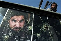 Roger-Viollet   213489   Second war in Afghanistan between the USA and the Northern Alliance against the Taliban following the September 11, 2001 attacks. Truck carrying Mujahideen fighters, with the portrait of the Commander Ahmad Shah Massoud, Northern Alliance's former leader. Afghanistan, September-October 2001.   © Jean-Paul Guilloteau / Roger-Viollet
