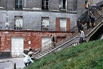 Roger-Viollet | 231181 | Children playing rue Vilin, in the district of Belleville. Paris (XXth arrondissement), May 1969. Photograph by Léon Claude Vénézia. | © Léon Claude Vénézia / Roger-Viollet