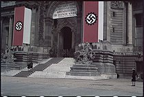 Roger-Viollet | 235779 | World War II. Swastika at the entrance of an exhibition reserved to the German soldiers in the Little Palais. Paris, 1943. Photograph by André Zucca (1897-1973). Bibliothèque historique de la Ville de Paris. | © André Zucca / BHVP / Roger-Viollet