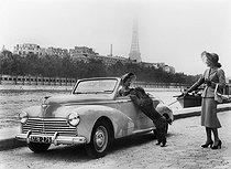 Roger-Viollet | 237824 | Paris, Car show. Model 203 Peugeot. Convertible top, 2 seats. Paris, October 1951. | © Jacques Boyer / Roger-Viollet