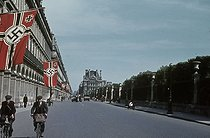 Roger-Viollet | 238790 | World War II. The rue de Rivoli with swastikas, towards the Louvre museum, Paris. Photograph by André Zucca (1897-1973). Bibliothèque historique de la Ville de Paris. | © André Zucca / BHVP / Roger-Viollet