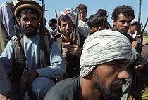 Roger-Viollet   238823   Second war in Afghanistan between the USA and the Northern Alliance against the Taliban following the September 11, 2001 attacks. Mujahideen of General Baba Jan at the airport of Bagram to the north of Kabul. Afghanistan, September-October 2001.   © Jean-Paul Guilloteau / Roger-Viollet