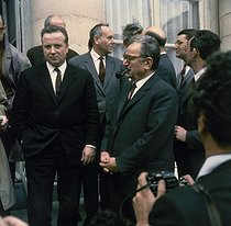 Roger-Viollet | 239272 | May-June 1968 events. Accords de Grenelle (Grenelle Agreements). Georges Séguy (representative of the CGT, Confédération Générale du travail, General Confederation of Labour) and Benoît Frachon (general secretary of the CGT) answering the journalists in the courtyard of the Ministry of Labour. Paris, on May 26, 1968. Photograph by Georges Azenstarck (born in 1934). | © Georges Azenstarck / Roger-Viollet