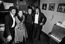 Roger-Viollet | 246211 | Gilbert Bécaud, Charles Aznavour, Georges Garvarentz and Serge Lama. Gala at the Olympia. Paris, on January 6, 1976. | © Patrick Ullmann / Roger-Viollet