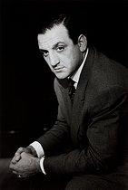 Roger-Viollet | 258301 | Lino Ventura (1919-1987), Italian actor. France, 1950. Photograph by Janine Niepce (1921-2007). | © Janine Niepce / Roger-Viollet