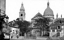 Roger-Viollet | 259198 | Paris Montmartre (XVIIIth district). The ancient church Saint-Pierre and the church of the Sacré-Coeur, about 1900. | © Neurdein / Roger-Viollet