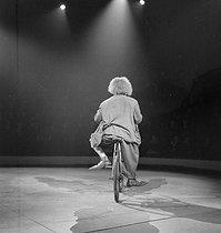 Roger-Viollet | 261765 | Circus : clown riding a bicycle. France, circa 1935. | © Gaston Paris / Roger-Viollet