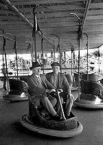 Roger-Viollet | 273435 | Bumper cars at a fun fair, 1908. | © Albert Harlingue / Roger-Viollet