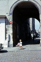 Roger-Viollet | 306421 | Young girl with her baby doll in the district of Belleville. Paris (XXth arrondissement), September 1966. Photograph by Léon Claude Vénézia. | © Léon Claude Vénézia / Roger-Viollet