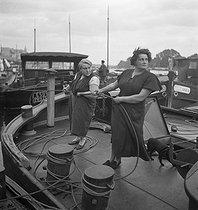 Roger-Viollet | 308965 | Life aboard a barge : deck cleaning. France, circa 1935. | © Gaston Paris / Roger-Viollet
