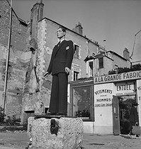 Roger-Viollet | 311024 | Display mannequin in front of a tailor's shop. Orléans (France), 1947. | © Pierre Jahan / Roger-Viollet