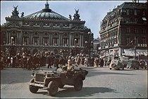 Roger-Viollet | 312899 | World War II. Jeep on the place de l'Opéra. Paris, August 1944. Photograph by André Zucca (1897-1973). Bibliothèque historique de la Ville de Paris. | © André Zucca / BHVP / Roger-Viollet
