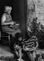 Roger-Viollet | 316835 | Boys spending their summer holidays at the farm with their grandmother. 1963. Photograph by Janine Niepce (1921-2007). | © Janine Niepce / Roger-Viollet