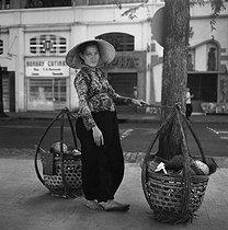 Roger-Viollet | 326562 | Woman selling durians. Saigon (Vietnam), January 1964. Photograph by Hélène Roger-Viollet (1901-1985). | © Hélène Roger-Viollet / Roger-Viollet