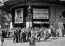 Roger-Viollet | 342884 | World War II. Showing for the pupils at the cinema Paramount, boulevard des Italiens. Paris. April 1942. | © LAPI / Roger-Viollet