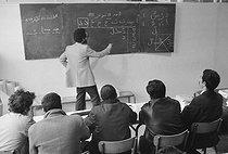 Roger-Viollet | 348505 | Alphabetisation lesson for migrant workers. France, 1980's. | © Georges Azenstarck / Roger-Viollet