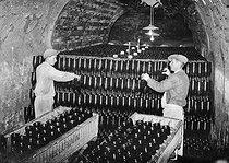 Roger-Viollet | 356124 | Cave de vin de Champagne  Moët et Chandon , Epernay (Marne), 1941. | © LAPI / Roger-Viollet