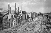 Roger-Viollet | 361304 | Portuguese community in a shanty town before its destruction. Nanterre (Hauts-de-Seine), 1967. | © Georges Azenstarck / Roger-Viollet