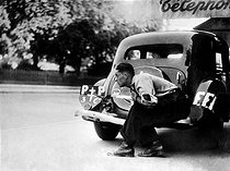 Roger-Viollet | 362169 | World War II. Liberation of Paris. Member of the French Forces of the Interior hiding behind a Citroën front-wheel drive car, August 1944. | © LAPI / Roger-Viollet