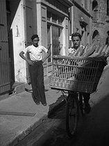 Roger-Viollet | 378970 | Apprentice baker delivering bread on a bicycle, 1938. | © Roger-Viollet / Roger-Viollet