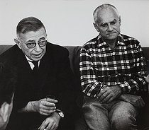 Roger-Viollet | 379442 | Jean-Paul Sartre and Alberto Moravia at the Venice Film Festival for the presentation of the film  Le mur  after Jean-Paul Sartre's book. Venice (Italy), 1967. Photograph by Janine Niepce (1921-2007). | © Janine Niepce / Roger-Viollet
