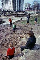 Roger-Viollet | 380214 | Children playing near a construction site, Place des Fêtes. Paris (XIXth arrondissement), April 1974. Photograph by Léon Claude Vénézia. | © Léon Claude Vénézia / Roger-Viollet