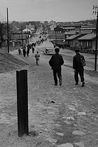 Roger-Viollet | 389663 | Miners walking to the mine of Merlebach. Freyming-Merlebach (France), 1958. Photograph by Jean Marquis (1926-2019). | © Jean Marquis / Roger-Viollet