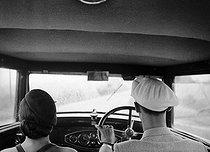 Roger-Viollet | 401823 | Couple in a car. France, 1933. | © Pierre Jahan / Roger-Viollet
