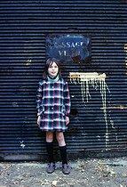 Roger-Viollet | 402574 | Young girl, passage Vilin, in the district of Belleville. Paris (XXth arrondissement), September 1967. Photograph by Léon Claude Vénézia (1941-2013). | © Léon Claude Vénézia / Roger-Viollet