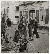 Roger-Viollet | 408787 | German soldiers painting, rue du Mont-Cenis, Montmartre, Paris (XVIIIth arrondissement). 1940. Photograph by Roger Schall (1904-1995). Paris, musée Carnavalet. | © Roger Schall / Musée Carnavalet / Roger-Viollet