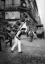 Roger-Viollet | 418830 | Basket carrier at the Halles. Paris, 1908. | © Jacques Boyer / Roger-Viollet