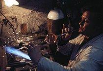 Roger-Viollet | 424954 | Glass-blower in his workshop. Paris, 1968. Photograph by Léon Claude Vénézia (1941-2013). | © Léon Claude Vénézia / Roger-Viollet
