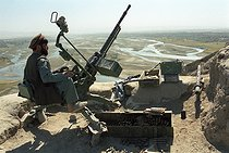 Roger-Viollet   429523   Second war in Afghanistan between the USA and the Northern Alliance against the Taliban following the September 11, 2001 attacks. Mujahideen artillery on the Northern Alliance front line in Aï-Khanoum near Khwadja Bahauddin. Afghanistan, September-October 2001.   © Jean-Paul Guilloteau / Roger-Viollet