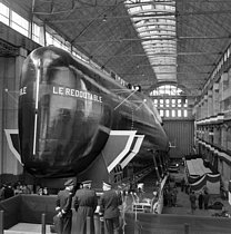 Roger-Viollet | 431037 | Baptism of the first French atomic submarine   Le Redoubtable  , before the launch. Cherbourg (Manche), March 29, 1967. JAC-20243-05 | © Jacques Cuinières / Roger-Viollet