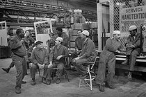 Roger-Viollet | 432131 | Algerian migrant workers at the Renault car manufacture. Boulogne-Billancourt (France), 1980's. | © Georges Azenstarck / Roger-Viollet