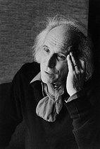Roger-Viollet | 433195 | Léo Ferré (1916-1993), French singer-songwriter, at the Hôtel Saint Jacques. Paris, 1980. Photograph by Jean Marquis (1926-2019). | © Jean Marquis / Roger-Viollet