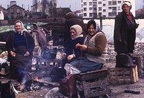 Roger-Viollet | 442133 | Portuguese immigrants in a shanty town. Saint-Denis (Seine-Saint-Denis), 1966-1967. | © Georges Azenstarck / Roger-Viollet