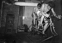 Roger-Viollet | 442572 | World War II. Tandem used to make electricity. Paris, August 1st, 1944. | © LAPI / Roger-Viollet