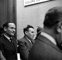 Roger-Viollet | 447520 | World War II. Louis-Ferdinand Céline (1894-1961), French writer, and Louis Lambert, attending a conference at the Institute for Jewish Affairs. Paris, May 1941. Photograph by Roger Berson. | © Roger Berson / Roger-Viollet