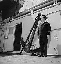 Roger-Viollet | 451550 | Anchor and sailor. France, 1934. | © Gaston Paris / Roger-Viollet