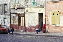 Roger-Viollet | 452535 | Children playing, rue Vilin, in the district of Belleville. Paris (XIXth arrondissement), November 1968. Photograph by Léon Claude Vénézia. | © Léon Claude Vénézia / Roger-Viollet
