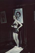 Roger-Viollet | 463065 | World War II. Display mannequin in a lingerie shop, avenue de l'Opéra. Photograph by André Zucca (1897-1973). Bibliothèque historique de la Ville de Paris. | © André Zucca / BHVP / Roger-Viollet