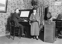 Roger-Viollet | 464468 | Beginning of the T.S.F. Mr and Mrs Garcia at the radio  Radiola . | © Maurice-Louis Branger / Roger-Viollet