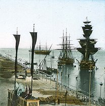 Roger-Viollet | 468910 | Inauguration of the Suez Canal (Egypt). Entrance of the port at Port Said. Detail of a colorized stereoscopic view. | © Léon & Lévy / Roger-Viollet