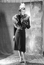 Roger-Viollet   479982   Hat, dress and fur stole designed by Maurice Simon, presented by Mrs. Maurice Simon. 1947.   © Laure Albin Guillot / Roger-Viollet