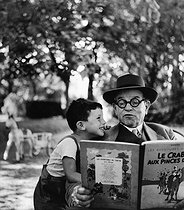 Roger-Viollet | 480109 | Two big Tintin lovers : Janine Niepce's father and her son. Rully (France), 1952. Photograph by Janine Niepce (1921-2007). | © Janine Niepce / Roger-Viollet